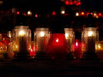 Candles lit at a church altar. Candles lit on a church altar Royalty Free Stock Images