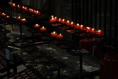 Candles lit church. Christianity and faith, terrorism royalty free stock photos