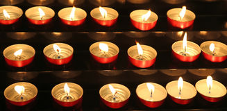 candles lit inside the place of worship to pray Stock Photography