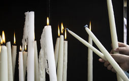 Candles lit lourdes. Candles lit in chapel of Lourdes, religious symbols and terrorism Royalty Free Stock Photos