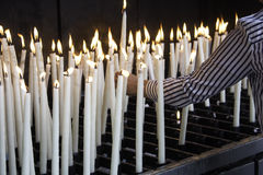 Candles lit lourdes. Candles lit in chapel of Lourdes, religious symbols and terrorism Stock Image