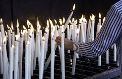 Candles lit lourdes. Candles lit in chapel of Lourdes, religious symbols and terrorism Royalty Free Stock Images