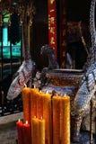 Candles lit on alter, Pagoda Chua Min Huong, Ho Chi Minh City Stock Photography