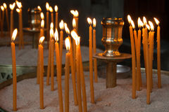 Candles lit in an Orthodox church - Cyclades Stock Photo