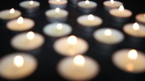 Candles are lit on the table. Candles burning in the darkness stock footage