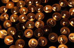 Candles lit with the warm flame during the religious rite Stock Image
