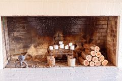 Candles And Logs In A Fireplace royalty free stock image