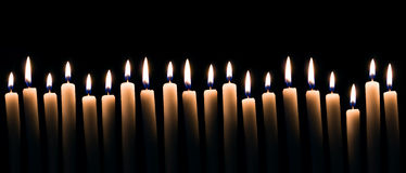 Candles. Lots of candles on a dark background stock photo