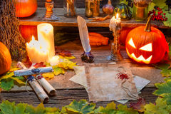 Candles, magic scrolls and pumpkins in the witch house Royalty Free Stock Photography