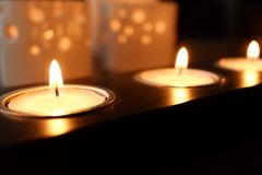 Candles for a warm illumination. Candles make a warm illumination. They are romantic, cheap and make no use of any energy stock photography