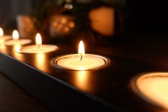 Candles for a warm illumination. Candles make a warm illumination. They are romantic, cheap and make no use of any energy stock image