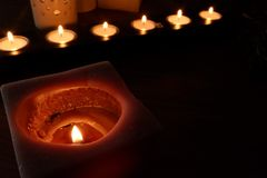 Candles for a warm illumination. Candles make a warm illumination. They are romantic, cheap and make no use of any energy stock photo