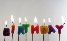 Candles making the word birthday. Over white background Stock Images