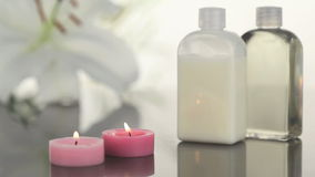 Candles and massage lotion in a Spa centre stock video