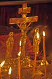 Candles near the crucifix in the church Royalty Free Stock Images