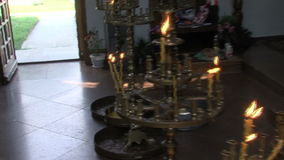 Candles near the portrait of Vanga in the church of St. Petka in Rupite, Bulgaria stock video