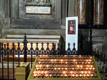 Candles near tomb in Milan Cathedral royalty free stock photo