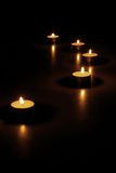 Candles At Night. Arrangement of candles in the night Royalty Free Stock Photo