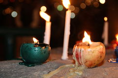 Candles. At night, colored round candles burn and melt Stock Photography