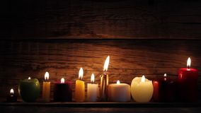 Candles in night in romantic mood. On vintage wooden boards stock footage