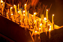 Candles at night. Candles are in the night which were lighten up by many people for respecting their religion Royalty Free Stock Photography