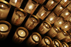 Candles at Notre Dame cathedral. Candles lit for prayers at the Notre Dame cathedral in Paris Stock Photo