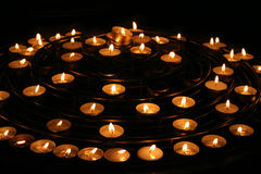 Candles in Notre Dame de Paris. Light candles placed in round shape, in Notre Dame de Paris, France stock image
