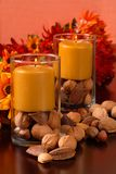 Candles with nuts and flowers Stock Image