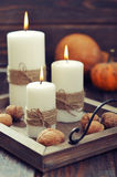 Candles with nuts and pumpkin Stock Photography