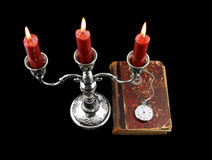 Candles and old book with watch isolated Royalty Free Stock Photography
