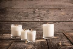 Candles on old wooden background Royalty Free Stock Images