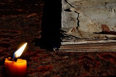 Candles on old wooden floor Old and weathered note paper Royalty Free Stock Images