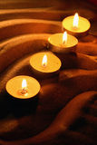 Candles On Sand Royalty Free Stock Photography
