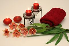 Candles and Orchid. Orchid, candles, leaves, and towel Royalty Free Stock Photography