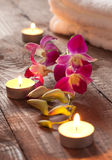 Candles and orchid Stock Photography