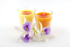Candles and orchid flower Stock Images