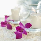 Candles and orchid flowers Royalty Free Stock Photography
