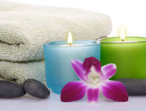 Candles, orchid, pebbles Stock Photo