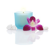 Candles, Orchid and Some White Pebbles Royalty Free Stock Images
