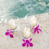 Candles and orchids. Royalty Free Stock Photo