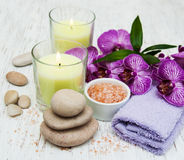 Candles, orcids and towels Stock Photos