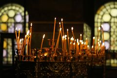 Candles in a orthodox church. Burning candles in a orthodox church, Bulgaria royalty free stock photos