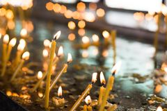 Candles in the orthodox Church. Shallow depth of field Stock Photo
