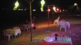 Candles on outdoor restaurant table tropical beach. Romantic setting for anniversary or honeymoon.  stock video footage