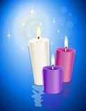 Candles over blue Royalty Free Stock Images