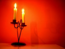Candles over orange. Two Candles over orange background Royalty Free Stock Photos
