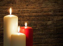 Candles over wood. Three candles over a old wood background Royalty Free Stock Photos