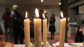The Candles At A Party. Four candles on a party table blured background with people stock footage