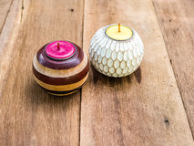 Candles in patterned holder Royalty Free Stock Photos
