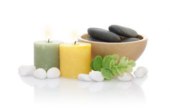 Candles and Pebble and Green Leaf Stock Images